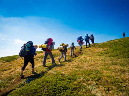 Hikers group trekking in Crimea mountains Foto de archivo