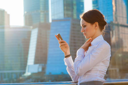 Business woman using smartphone  Urban background photo