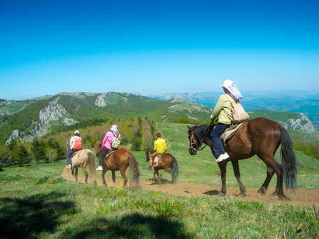 horseback: Horse riders traveling in the mountains