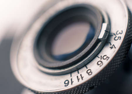 Closeup of old retro film camera lens photo