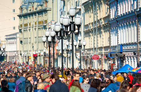 sights of moscow: MOSCOW - April 13: Many people walking on the famous Arbat street on April 13, 2014 in Moscow. This street is one of the few pedestrian streets in Moscow, which is usually visited by tourists.