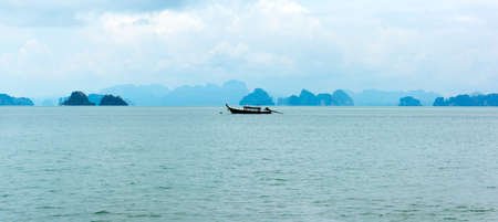 Traditional longtail boat on the small islans panorama in Thailand photo