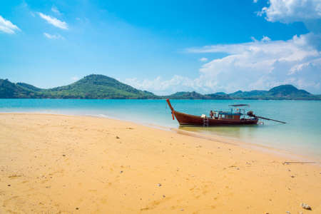 Traditional longtail boat near tropical island, Thailand photo