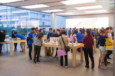 HONG KONG - APRIL 7: Buyers and shop assistants at Apple store on April 7, 2014 in Hong Kong. Apple store locates in IFC Mall, it is very popular with locals and tourists visiting Hong Kong.