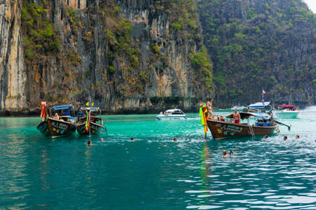 PHI PHI ISLANDS, THAILAND - APRIL 4: Unidentified people visit and swim in lagoon with turquoise water on April 4, 2014 in Phi Phi Islands, Thailand.