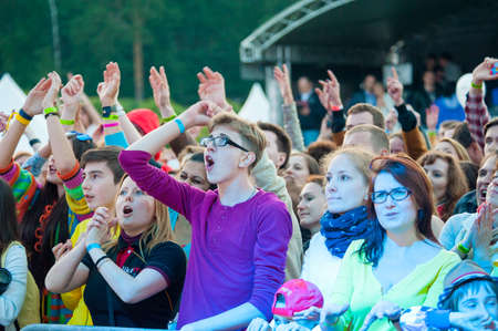 MOSCOW - JUNE 14: People cheering at open-air concert on XI International Jazz Festival Usadba Jazz in Archangelskoye Museum-Mansion on June 14, 2014 in Moscow