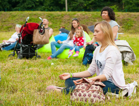 MOSCOW - JUNE 14: People attend open-air concert on XI International Jazz Festival Usadba Jazz in Archangelskoye Museum-Mansion on June 14, 2014 in Moscow