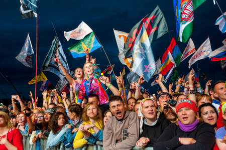 BIG ZAVIDOVO, RUSSIA - JULY 4: People cheering at open-air rock festival Nashestvie on July 4, 2014 in Big Zavidovo, Russia. Nashestvie is the biggest rock festival in Russia, more 200000 visitors
