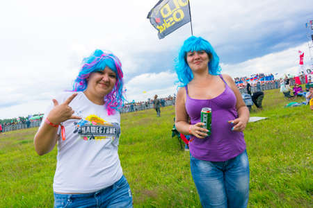 BIG ZAVIDOVO, RUSSIA - JULY 4: People attend open-air rock festival Nashestvie on July 4, 2014 in Big Zavidovo, Russia. Nashestvie is the biggest rock festival in Russia, more than 200000 visitors