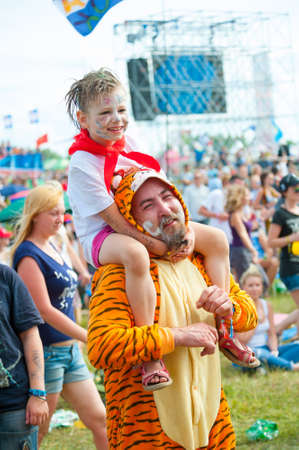 BIG ZAVIDOVO, RUSSIA - JULY 5: People attend open-air rock festival Nashestvie on July 5, 2014 in Big Zavidovo, Russia. Nashestvie is the biggest rock festival in Russia, more than 200000 visitors