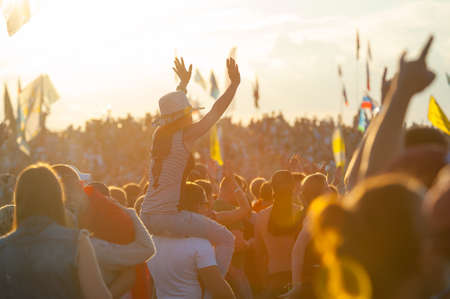 BIG ZAVIDOVO, RUSSIA - JULY 5: People cheering at open-air rock festival Nashestvie on July 5, 2014 in Big Zavidovo, Russia. Nashestvie is the biggest rock festival in Russia, more 200000 visitors
