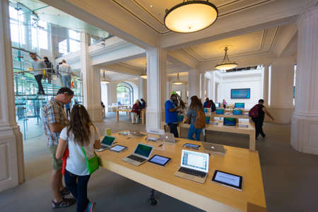 AMSTERDAM - AUGUST 28: Buyers and shop assistants at Apple store on August 28, 2014 in Amsterdam.