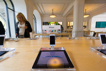 AMSTERDAM - AUGUST 28: Buyer examines new Iphone at Apple store on August 28, 2014 in Amsterdam.