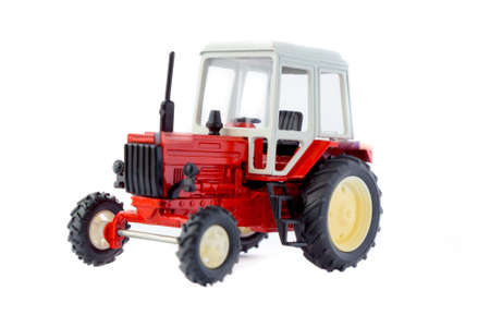 Toy tractor isolated model on white photo