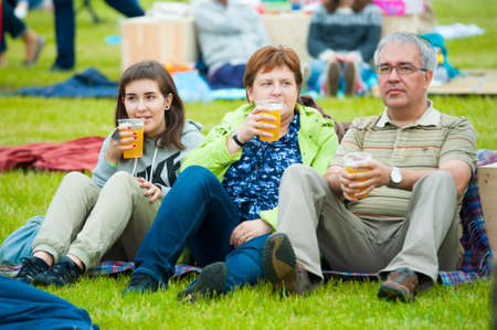 international beer: MOSCOW - JUNE 20, 2015: Family drink beer on XII International Jazz Festival Usadba Jazz in Tsaritsyno Park on June 20, 2015 in Moscow