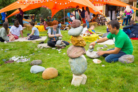 fulcrum: MOSCOW - JUNE 20, 2015: People build cairns on XII International Jazz Festival Usadba Jazz in Tsaritsyno Park on June 20, 2015 in Moscow