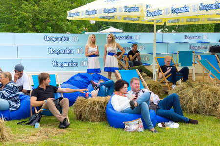 international beer: MOSCOW - JUNE 21, 2015: Hoegaarden makes non-alcoholic beer promotion campaign on XII International Jazz Festival Usadba Jazz in Tsaritsyno Park on June 21, 2015 in Moscow Editorial