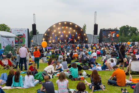 attend: MOSCOW - JUNE 20, 2015: People attend open-air concert on XII International Jazz Festival Usadba Jazz in Tsaritsyno Park on June 20, 2015 in Moscow