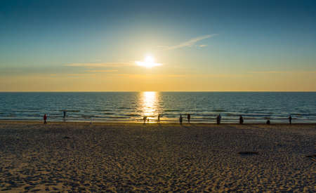 baltic people: People meet sunset on Baltic Sea coast Stock Photo