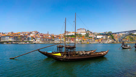 rabelo: Porto, Portugal old town skyline on the Douro River with rabelo boats