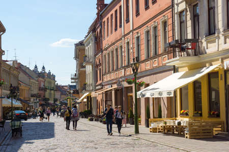 kaunas: KAUNAS, LITHUANIA - JUNE, 01: People walk on a pedestrian street on June 01, 2015 in Kaunas, Lithuania.