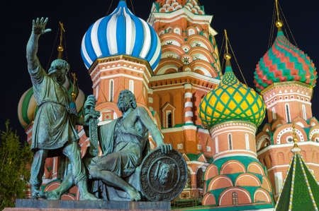 minin: Monument to Minin and Pozharsky on the Red Square in Moscow Russia at night. Saint Basils Cathedral on the background.
