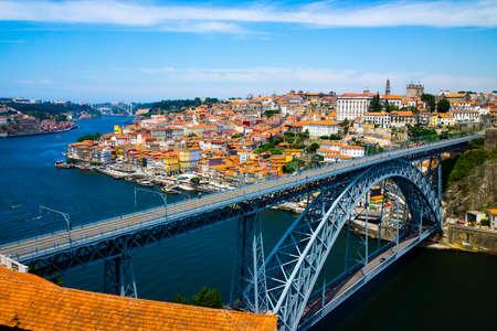 luis: Porto old town skyline on the Douro River with famous landmark Luis bridge Stock Photo