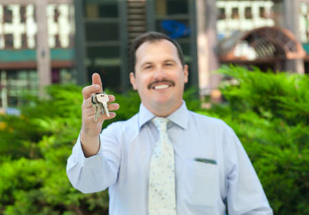 executive apartment: Realtor holding out the keys to the property