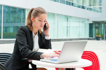 working woman: Young business woman working portrait