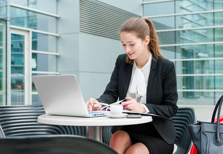 woman  laptop: Young business woman working portrait