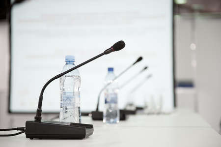 microphone: Table microphone at conference hall Stock Photo