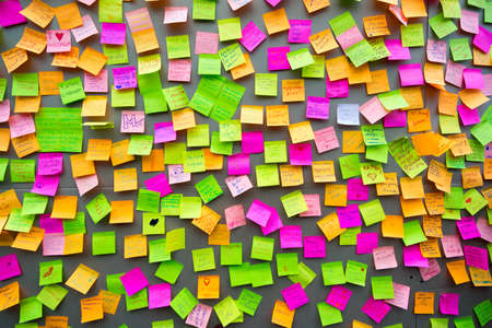 Many different colors paper notes on the wall
