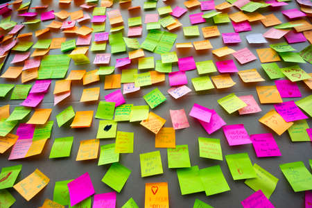 sticky: Many different colors paper notes on the wall