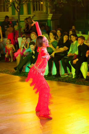 latino dance: MOSCOW - OCTOBER 18: Unidentified female children age 10-12 compete in latino dance on the Artistic Dance Awards 2014-2015, organized by World Dance Artistic Federation on October 18, 2015 in Moscow.