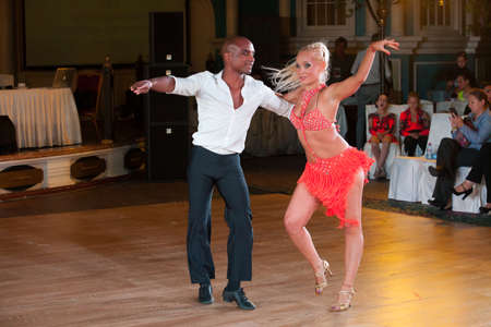 latino dance: MOSCOW - OCTOBER 18: Unidentified couple compete in latino dance on the Artistic Dance Awards 2014-2015, organized by World Dance Artistic Federation on October 18, 2015 in Moscow.