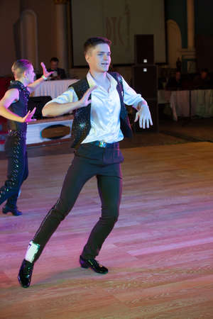 latino dance: MOSCOW - OCTOBER 18: Unidentified male teens age 15-18 competes in latino dance on the Artistic Dance Awards 2014-2015, organized by World Dance Artistic Federation on October 18, 2015 in Moscow.