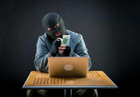 counts: Cybercriminal man counts euro cash