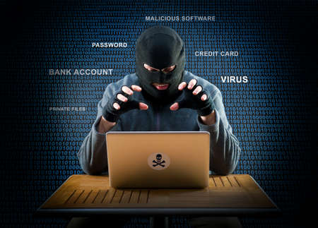 Hacker is ready to start hacking laptop Foto de archivo