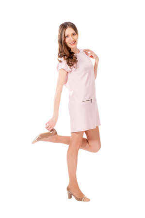pink posing: Young slim pretty woman in pink dress posing isolated on white background