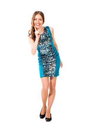 threatens: Young slim pretty woman in blue dress with sequins threatens a finger isolated on white background