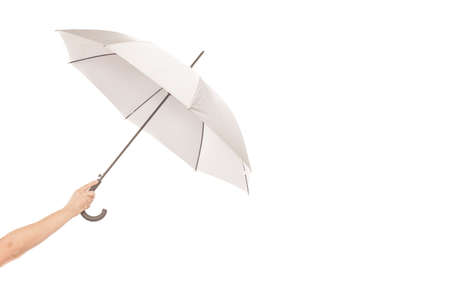 umbrela: Umbrela in a hand isolated on white Stock Photo