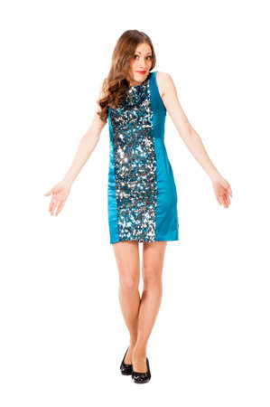 spreads: Young slim pretty woman in blue dress with sequins shrugs and spreads hands isolated on white background Stock Photo