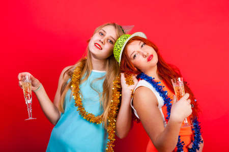 christmas hats: Young nice girls have fun on a party