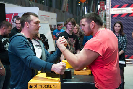 wrestle: MOSCOW, RUSSIA - NOVEMBER 21, 2015: Men compete in armwrestling at exhibition of sports nutrition SN Pro Expo Forum 2015 on November 21, 2015 in Moscow, Russia Editorial