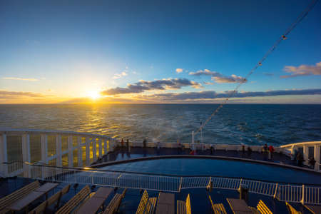 baltic people: People travel on large ferry in Baltic sea at sunrise Stock Photo