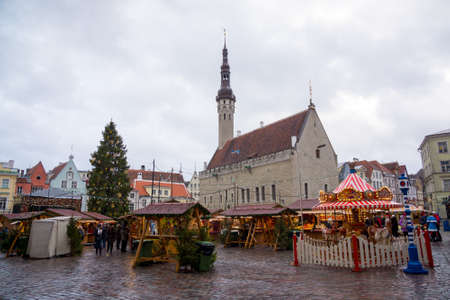 december 25: TALLINN, ESTONIA - DECEMBER 25: People visit Christmas Fair in old town on December 25, 2015 in Tallinn, Estonia