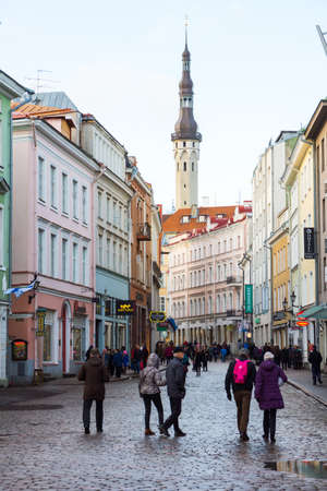 december 25: TALLINN, ESTONIA - DECEMBER 25: People walking on the street in old city on December 25, 2015 in Tallinn, Estonia