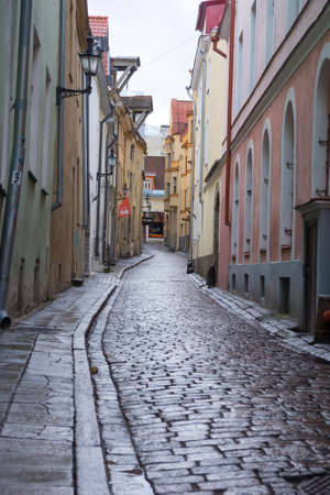 december 25: TALLINN, ESTONIA - DECEMBER 25: Cobbled street in old city at daytime on December 25, 2015 in Tallinn, Estonia
