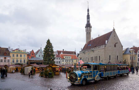 december 25: TALLINN, ESTONIA - DECEMBER 25: People visit Christmas Fair in old town on December 25, 2015 in Tallinn, Estonia