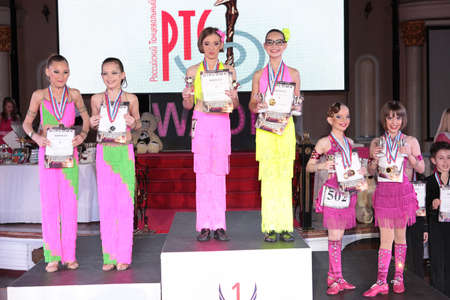dace: MOSCOW - MARCH 19: Unidentified children age 8-18 awarding at artistic dances at European Artistic Dace Championship, organized by World Dance Artistic Federation on March 19, 2016, in Moscow.